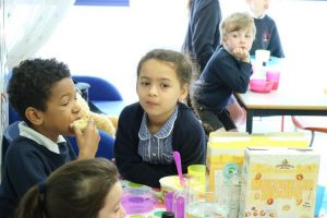 eating breakfast 300x200 - New Breakfast & Afterschool Clubs at St Mary's School, Chessington