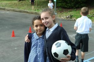 girls playing football 300x200 - New Breakfast & Afterschool Clubs at St Mary's School, Chessington