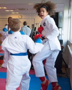 karate kids jumping 240x300 - Karate success at YMCA Hawker