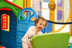 Child playing inside the soft play area in YMCA Surbiton cafe
