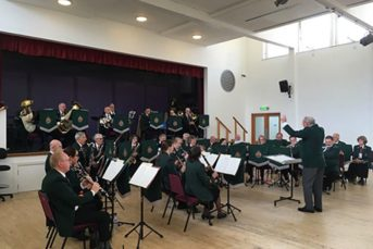 Big Band performance with conductor