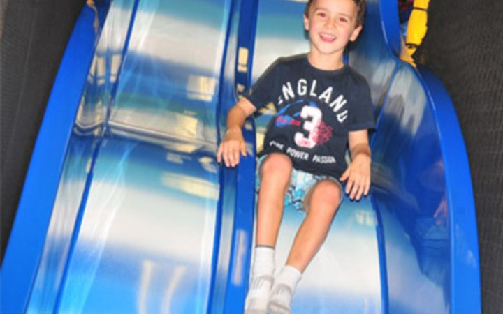 Young boy on slide