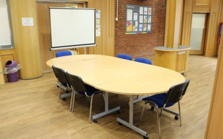 Empty meeting room for hire with conference table and chairs
