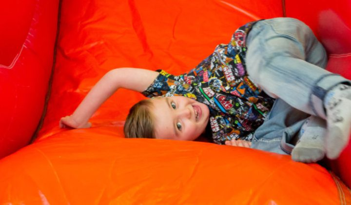 Young boy playing in soft play bouncy castle
