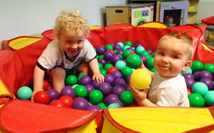 Toddler and baby playing Soft Play in ball pit at YMCA Wimbledon