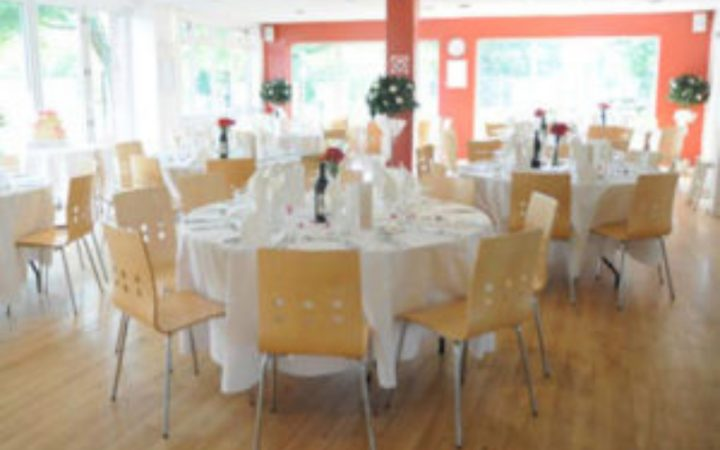 Empty function room with decorated tables and chairs