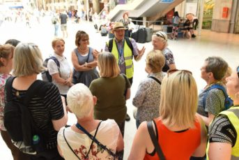 Gathering of mature adults in shopping centre