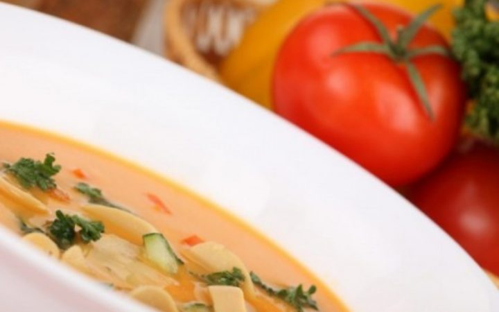 Bowl of soup with fresh tomatoes