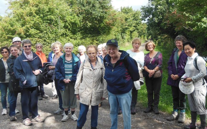 Mature women in walking group outdoors
