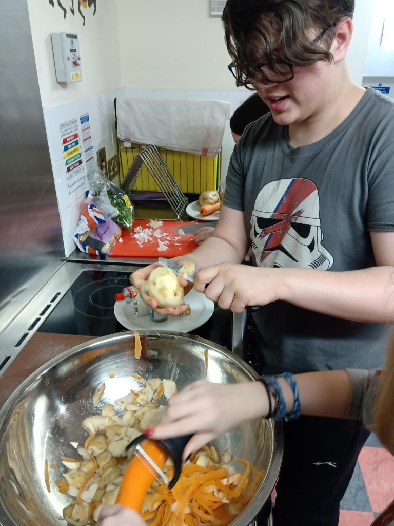 Children cooking at Hampton Youth Project