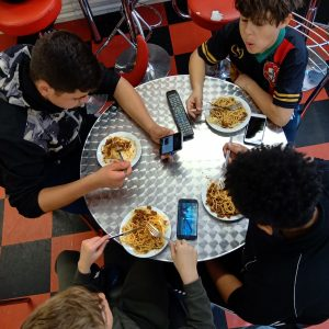 Young boys eating around a table at Hampton Youth Project