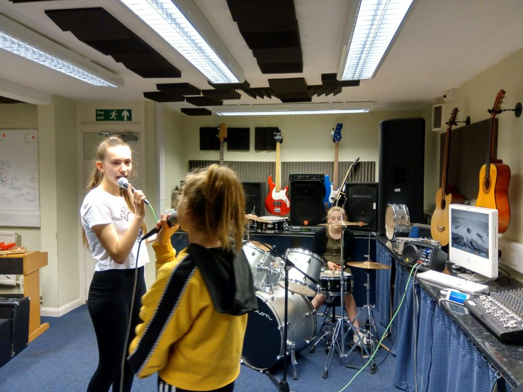 Hampton Youth Project. Girls playing music