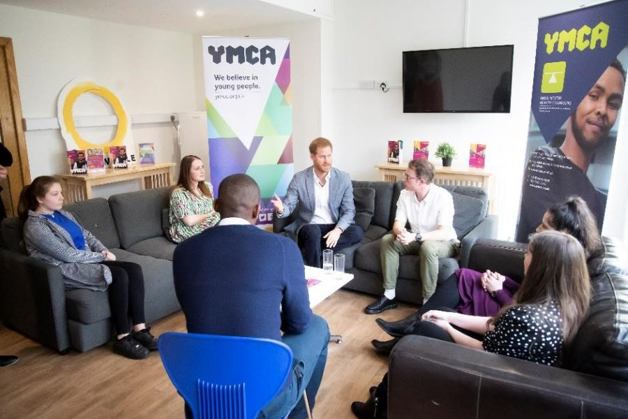 People sitting and taking with Prince Harry at YMCA Ealing