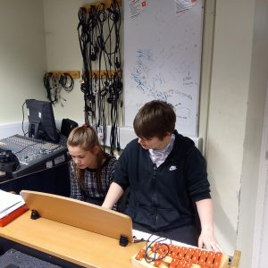 Teens playing keyboard at Hampton Youth project