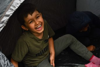 Laughing male child in tent