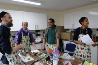 YMCA residents cooking in kitchen