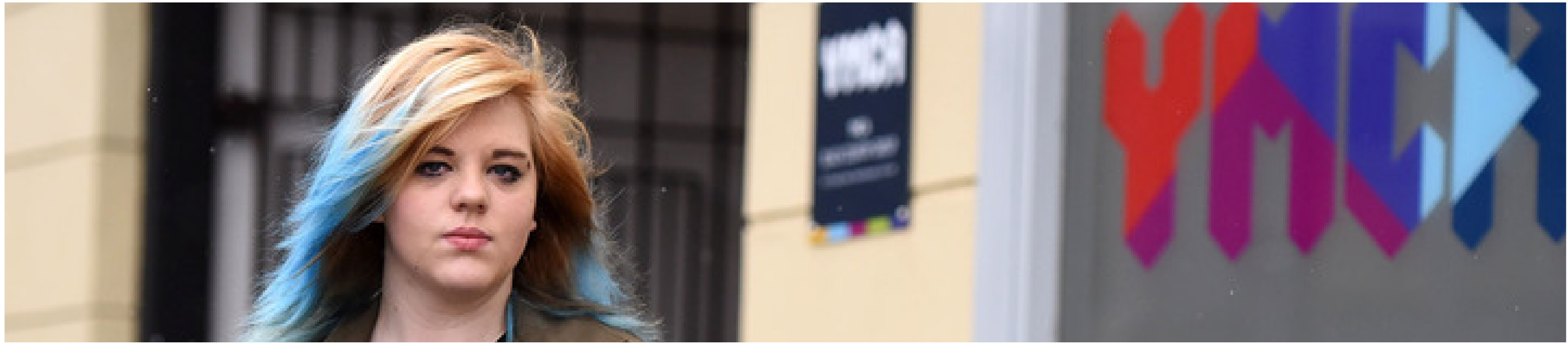young woman outside a YMCA - Our jobs
