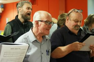 mature men singing choir02 300x200 - The YMCA Community Choir