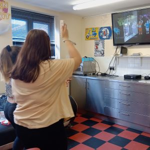two young women playing a dance video game
