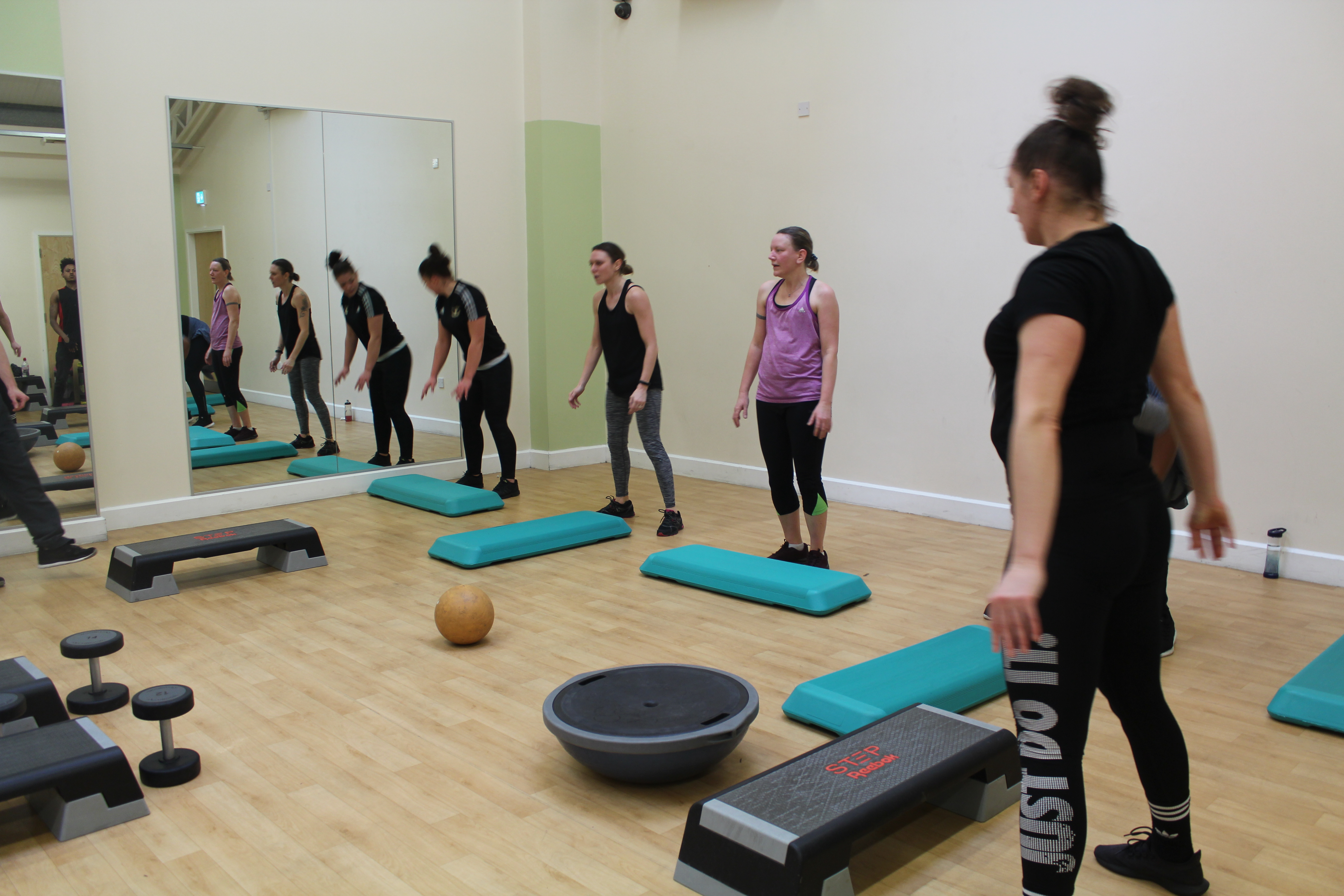Women in group exercise class