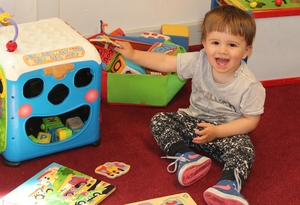 small boy playing with toys