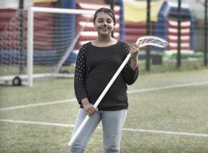 girl holding a hockey stick