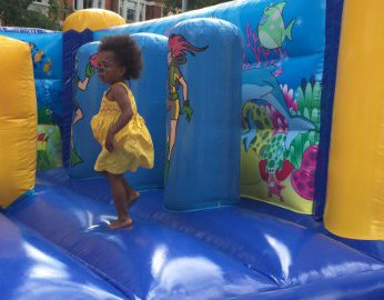 Young girl on bouncy castle