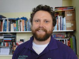 YMCA Chaplain with beard, happy