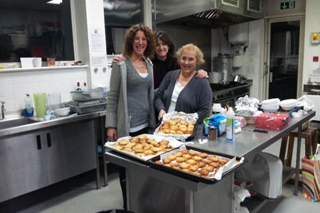 Three woman posing with newly cooked food