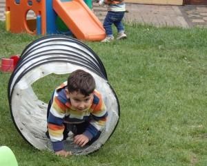 child in play tube