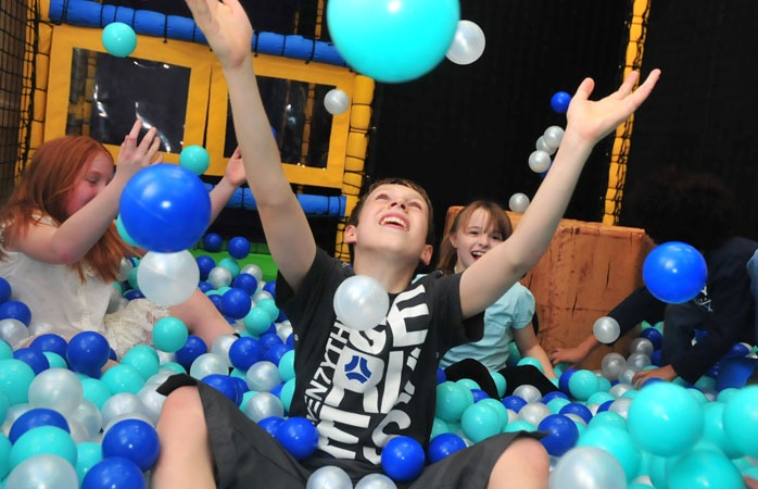 Children in soft play ball pit