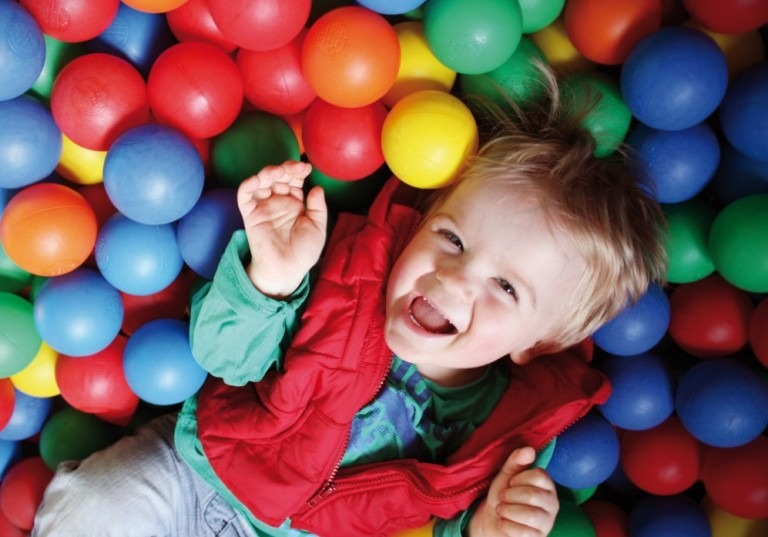Boy playing in a ballpit