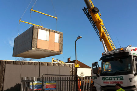 YCube being lifted on to the building