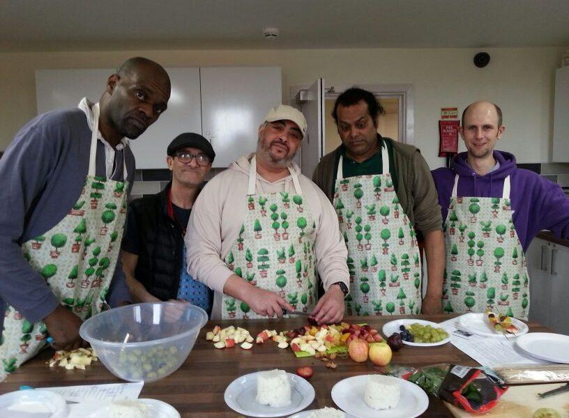 Men preparing food in kitchen