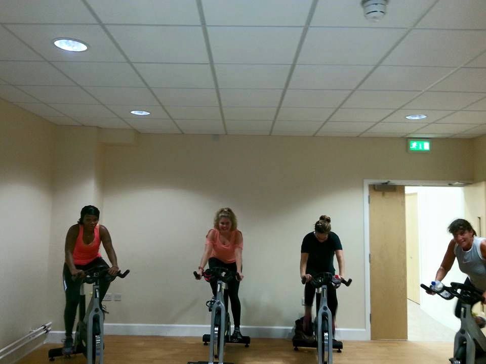Women cycling in group class