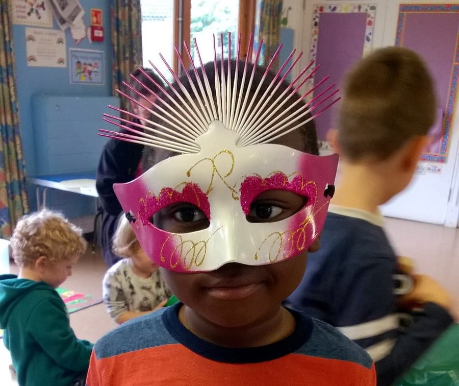 Child in brilliant mask